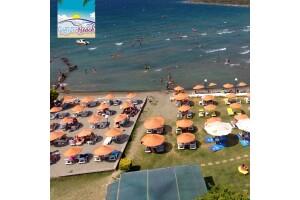 Çeşme Günizi Beach'te Şezlon ve Şemsiye Dahil Gün Boyu Plaj Girişi, Patates Kızartması, 1 Adet Yerli İçecek